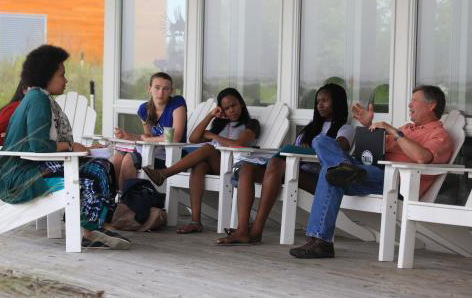 students having class on porch at Marine Lab