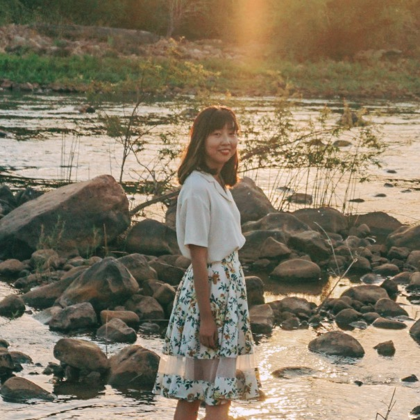 Serene Cheng beside a river