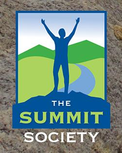 Summit Society logo - silhouette of person with arms up at top of a mountain
