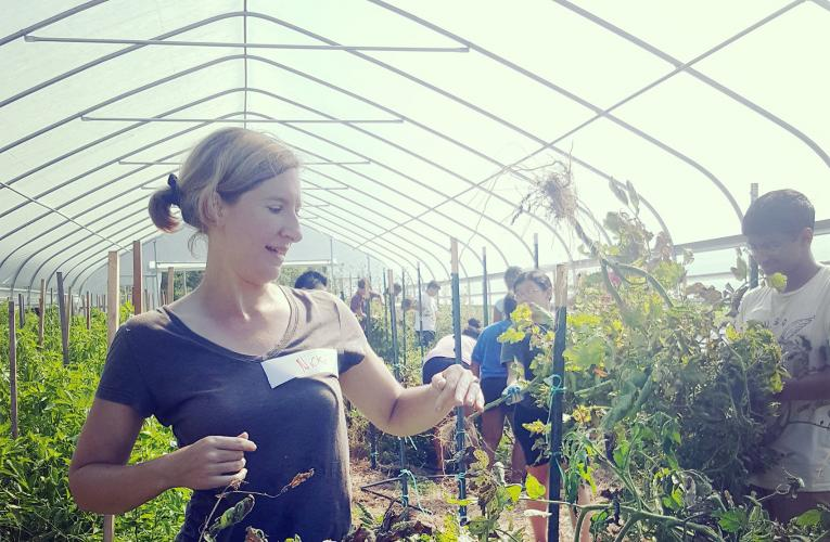 Nicki Cagle in greenhouse