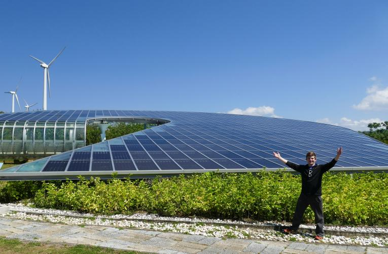 Student in front of a solar panel