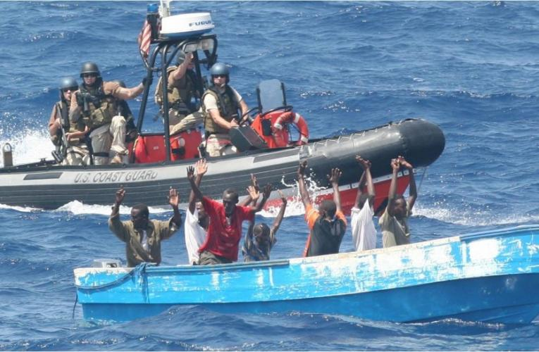 Suspected pirates surrender to a U.S. Coast Guard patrol boat