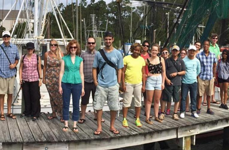 Group of Marine Lab staff and students on a dock