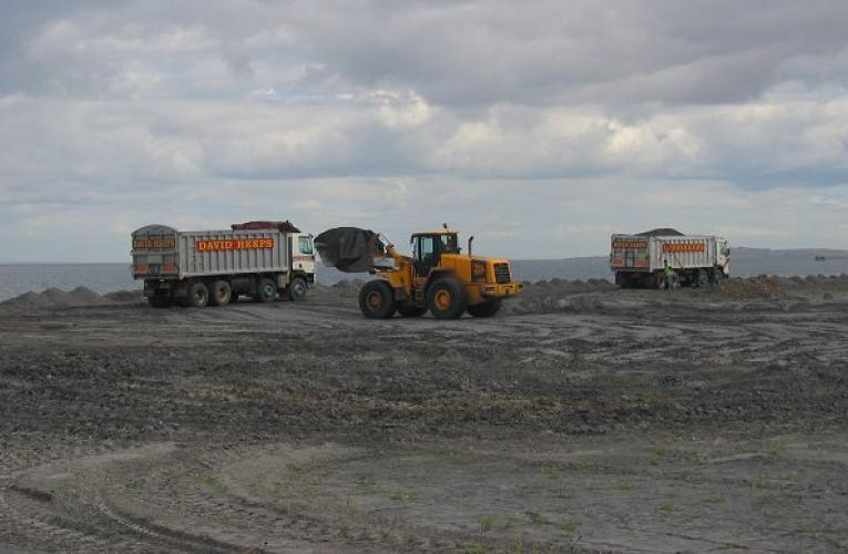 Trucks collecting coal ash